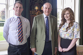 Sir Tom Cowie Memorial Scholarship winners Robin Watson and Alex Bowey are pictured with Chairman of Trustees of the Sir Tom Cowie Charitable Trust, David Gray, FRICS